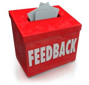 A red Feedback box for collecting employee or customer ideas, th